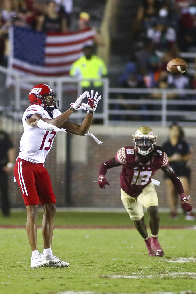 Jacksonville State wide receiver P.J. Wells (13) catches a pass as Florida State defensive back Travis Jay (18) defends in the fourth quarter of an NCAA college football game Saturday, Sept. 11, 2021, in Tallahassee, Fla. Jacksonville State won 20-17. (AP Photo/Phil Sears)