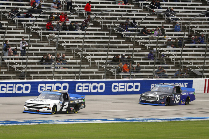 NASCAR Truck Series drivers Sheldon Creed (2) and Austin Hill (16) race down the front stretch during a an auto race at Texas Motor Speedway in Fort Worth, Texas, Sunday Oct. 25, 2020. (AP Photo/Richard W. Rodriguez)