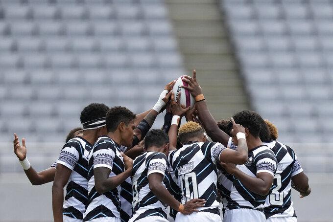 Fiji players huddle up at the start of their women's rugby sevens semifinal match against New Zealand at the 2020 Summer Olympics, Saturday, July 31, 2021 in Tokyo, Japan. (AP Photo/Shuji Kajiyama)
