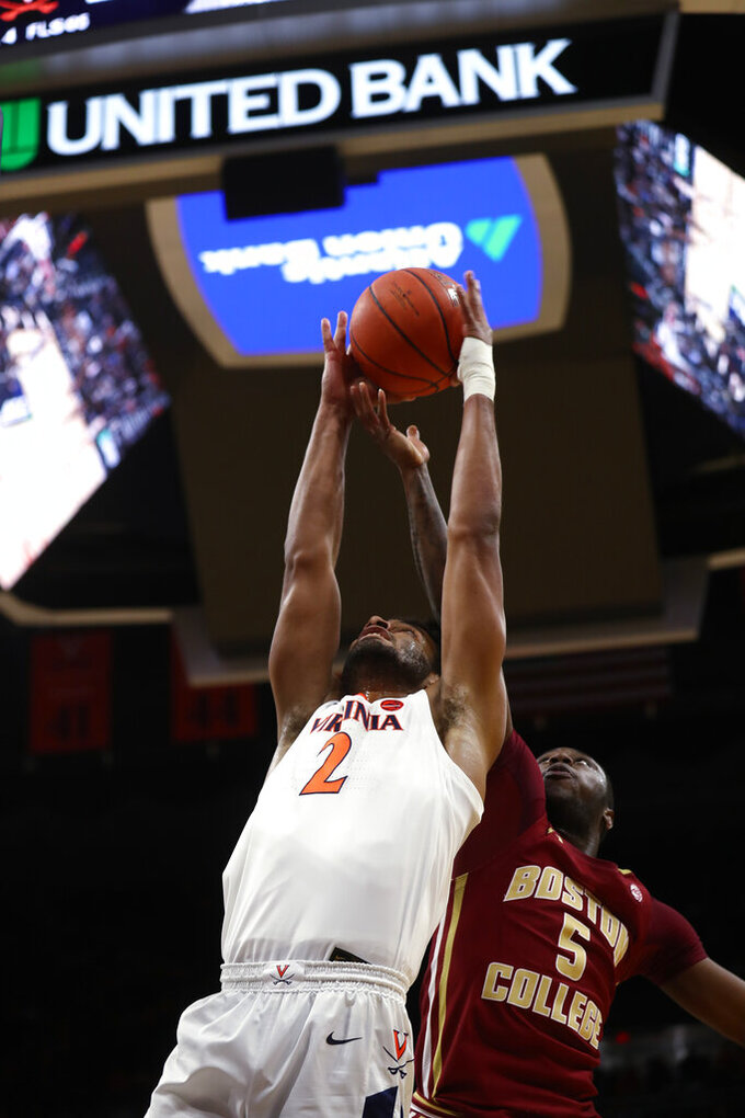 Virginia guard Braxton Key (2) grabs a rebound next to Boston College's Jay Heath during an NCAA college basketball game Wednesday, Feb. 19, 2020, in Charlottesville, Va. (Erin Edgerton/The Daily Progress via AP)