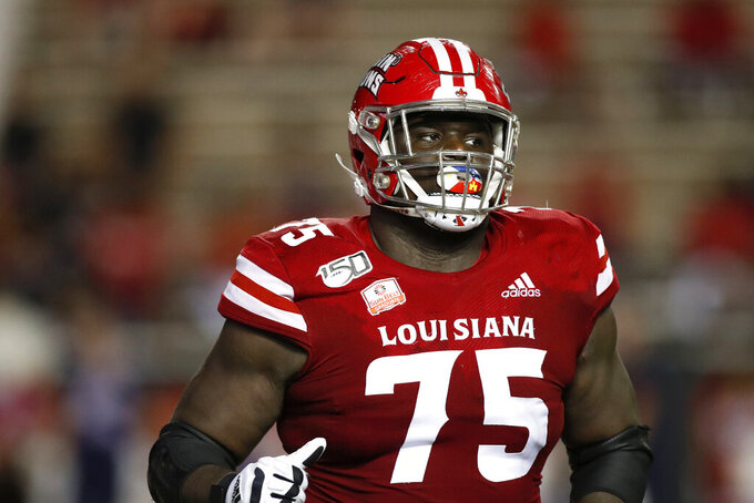 FILE - In this Sept. 7, 2019, file photo, Louisiana Lafayette offensive lineman Kevin Dotson (75) plays during an NCAA college football game against Liberty, in Lafayette, La. Dotson was selected to The Associated Press All-America team, Monday, Dec. 16, 2019. (AP Photo/Tyler Kaufman, File)