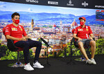 Ferrari drivers Sebastian Vettel of Germany, right, and Charles Leclerc of Monaco attend a media conference at the Mugello racetrack, in Scarperia, Italy, Thursday, Sept. 10, 2020, ahead of Sunday's Formula One Grand Prix of Tuscany. (Clive Mason, Pool Photo via AP)