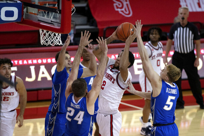 St. John's guard Julian Champagnie shoots against the Creighton defense during the second half of an NCAA college basketball game Thursday, Dec. 17, 2020, in New York. (AP Photo/Kevin Hagen)