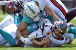 Miami Dolphins outside linebacker Andrew Van Ginkel (43) and outside linebacker Jaelan Phillips (15) team up to sack Tampa Bay Buccaneers quarterback Tom Brady (12) during the first half of an NFL football game Sunday, Oct. 10, 2021, in Tampa, Fla. (AP Photo/Jason Behnken)