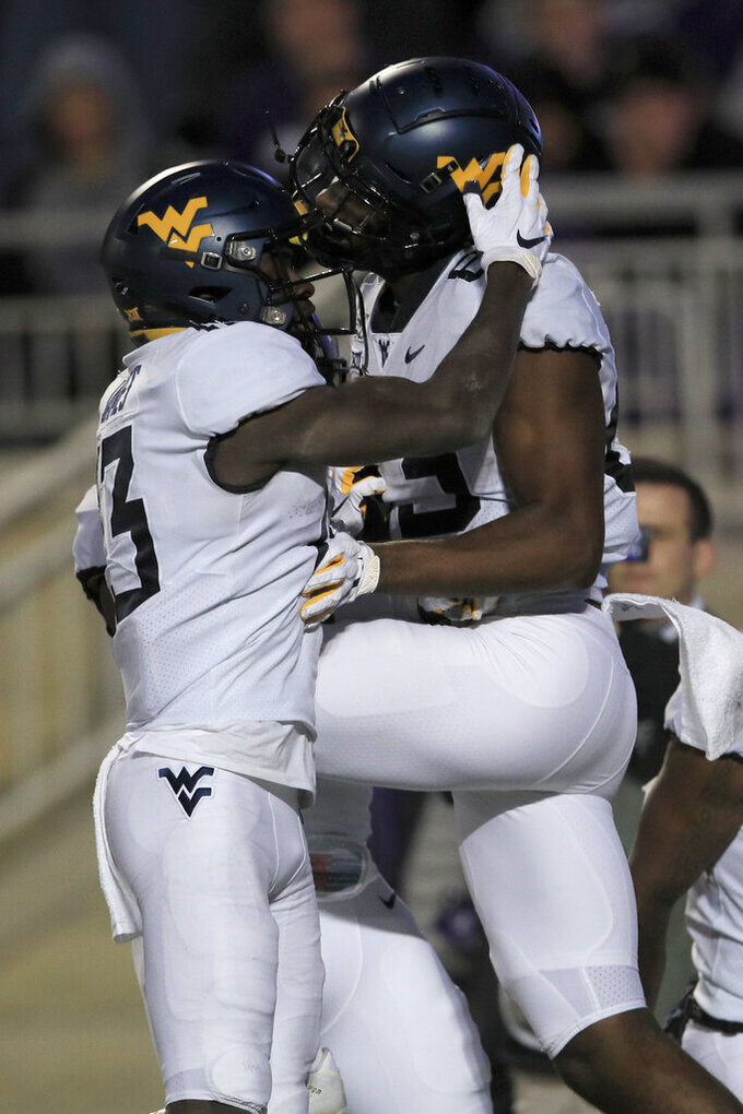 Doege leads West Virginia to 24-20 upset of K-State