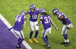 Minnesota Vikings wide receiver Justin Jefferson (18) celebrates with teammates after he ran for a 71-yard touchdown in the third quarter of an NFL football games against the Tennessee Titans, Sunday, Sept. 27, 2020 in Minneapolis. (Elizabeth Flores/Star Tribune via AP)