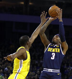 Denver Nuggets' Torrey Craig, right, shoots against Golden State Warriors' Kevin Durant during the first half of an NBA basketball game Friday, March 8, 2019, in Oakland, Calif. (AP Photo/Ben Margot)