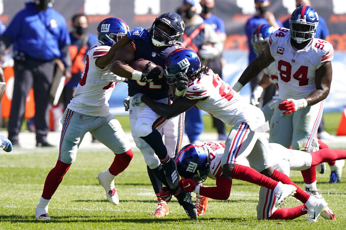 Chicago Bears running back David Montgomery (32) runs against the New York Giants during the second half of an NFL football game in Chicago, Sunday, Sept. 20, 2020. (AP Photo/Nam Y. Huh)