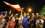 People protest outside the Polish parliament after lawmakers passed a bill seen as harmful to media freedom in Warsaw, Poland, Aug. 11, 2021. Poland's parliament voted Wednesday in favor of a bill that would force Discovery Inc., the U.S. owner of Poland's largest private television network, to sell its Polish holdings and is widely viewed as an attack on media independence in Poland. (AP Photo/Czarek Sokolowski)