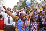 FILE - In this Oct. 13, 2015 file photo, women from Kenya, Uganda, Tanzania, Rwanda and Burundi participate in the world march of woman in Nairobi, Kenya. The World Health Organization says the practice constitutes an