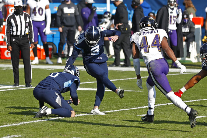 Tennessee Titans kicker Stephen Gostkowski (3) kicks a 45-yard field goal as Baltimore Ravens cornerback Marlon Humphrey (44) rushes in the first half of an NFL wild-card playoff football game Sunday, Jan. 10, 2021, in Nashville, Tenn. (AP Photo/Wade Payne)