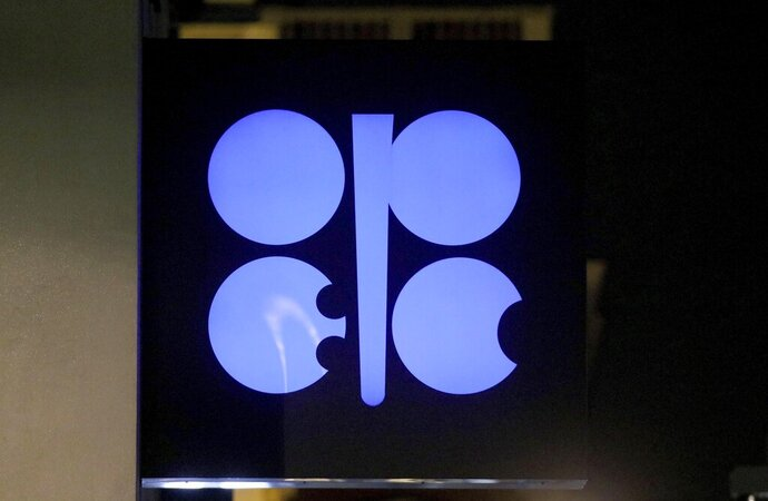 FILE - In this Thursday, Dec. 5, 2019, file photo, the advertising label of the Organization of the Petroleum Exporting Countries, OPEC, shines at their headquarters in Vienna, Austria. Ministers from the OPEC cartel have agreed to allow more oil to flow from the taps, saying demand for oil is growing as economies take steps to re-open. But they also cautioned that they could revisit the decision in an emergency meeting if there are serious lockdowns that further reduce demand for oil. (AP Photo/Ronald Zak, File)