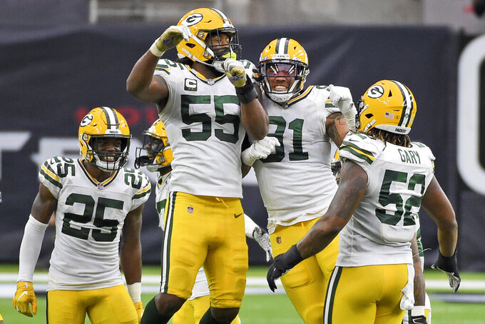 Green Bay Packers' Za'Darius Smith (55) and Preston Smith (91) celebrate as Will Redmond (25) and Rashan Gary (52) watch during the second half of an NFL football game against the Houston Texans Sunday, Oct. 25, 2020, in Houston. (AP Photo/Eric Christian Smith)