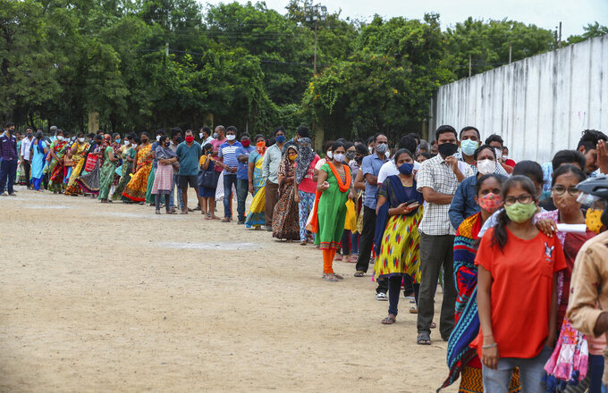Hundreds of people line up to receive their second dose of vaccine against the coronavirus at the municipal ground in Hyderabad, India, Thursday, July 29, 2021. (AP Photo/Mahesh Kumar A.)