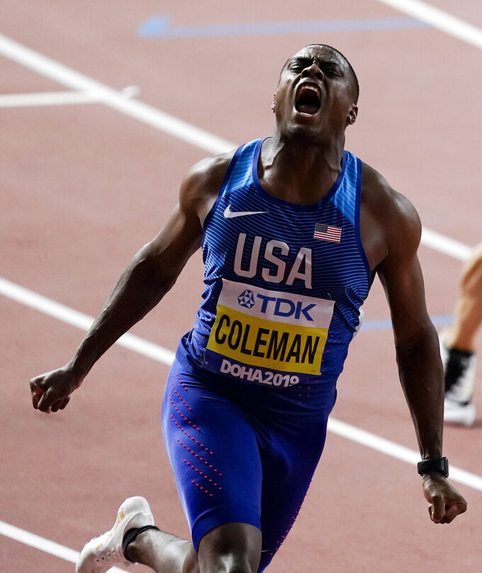 FILE - In this Sept. 28, 2019, file photo, Christian Coleman, of the United States, celebrates after crossing the line to win the gold medal in men's 100 meter final at the World Athletics Championships in Doha, Qatar. (AP Photo/Nick Didlick)