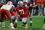 FILE - In this Saturday, Dec. 28, 2019, file photo, Ohio State center Josh Myers (71) during the first half of the Fiesta Bowl NCAA college football game against Clemson, in Glendale, Ariz. These times amid the coronavirus pandemic have brought an extra level of anxiety for current college players hoping for a stellar season or at least one that will raise their profile with NFL scouts. (AP Photo/Rick Scuteri, File)