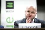 Chair of the Compliance Review Committee (CRC) Jonathan Taylor speaks during a press conference after the WADA's extraordinary Executive Committee (ExCo) on the Russian doping data manipulation, in Lausanne, Switzerland, Monday, Dec. 9, 2019. WADA bans Russia from international sporting events for four years. (Laurent Gillieron/Keystone via AP)