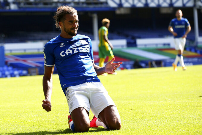 Everton's Dominic Calvert-Lewin celebrates after scoring his side's fifth goal during the English Premier League soccer match between Everton and West Bromwich Albion at Goodison Park in Liverpool, England Saturday, Sept. 19, 2020. (Alex Livesey/Pool via AP)