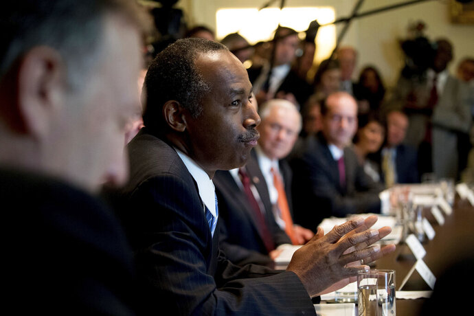 """FILE - In this Monday, June 12, 2017 file photo, Housing and Urban Development Secretary Ben Carson speaks during a Cabinet meeting with President Donald Trump in the Cabinet Room of the White House in Washington. Carson, a member of the Seventh Day Adventist church, pushed back at the separation of church and state during his GOP presidential primary campaign in 2016, touting the nation's """"Judeo-Christian foundation"""" to one Iowa voter. (AP Photo/Andrew Harnik)"""