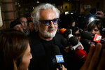 Former Formula One boss Flavio Briatore speaks to reporters in Rome in this Jan. 15, 2019 photo made available Tuesday Aug. 25, 2020. Briatore has reportedly been admitted to hospital in Milan with coronavirus, there has been no official statement from the hospital but multiple reports say Briatore's condition is serious but he is not in intensive care. (Fabio Cimaglia/LaPresse via AP)