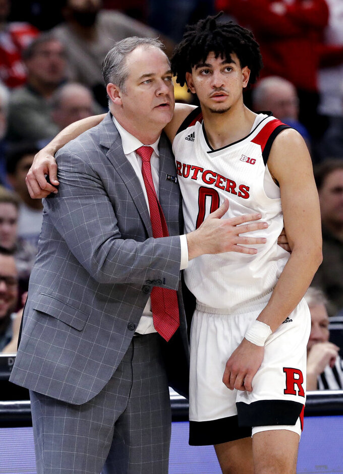 Rutgers head coach Steve Pikiell, left, and guard Geo Baker react during the second half of an NCAA college basketball game in the first round of the Big Ten Conference tournament against Nebraska in Chicago, Wednesday, March 13, 2019. Nebraska won 68-61. (AP Photo/Nam Y. Huh)