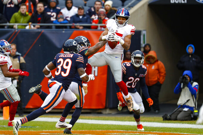 New York Giants wide receiver Golden Tate (15) makes a catch for a touchdown over Chicago Bears cornerback Buster Skrine (24) during the second half of an NFL football game in Chicago, Sunday, Nov. 24, 2019. (AP Photo/Paul Sancya)
