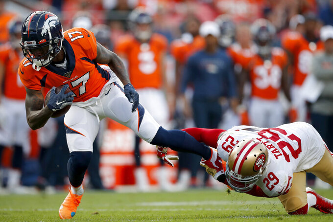 Denver Broncos wide receiver DaeSean Hamilton (17) is tackle by San Francisco 49ers strong safety Jaquiski Tartt (29) during an NFL preseason football game, Monday, Aug. 19, 2019, in Denver. (AP Photo/David Zalubowski)
