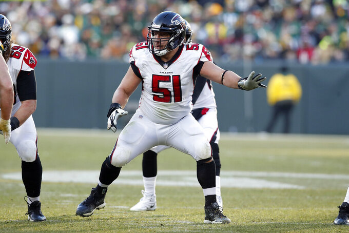FILE - In this Dec. 9, 2018, file photo, Atlanta Falcons center Alex Mack (51) sets to block against the Green Bay Packers during an NFL football game in Green Bay, Wis. Pro Bowl center Alex Mack liked how the Falcons' offensive line overcame injuries to produce a better effort in the second game. Now the challenge comes in being successful consistently as the Falcons prepare to visit Indianapolis. (AP Photo/Jeff Haynes, File)