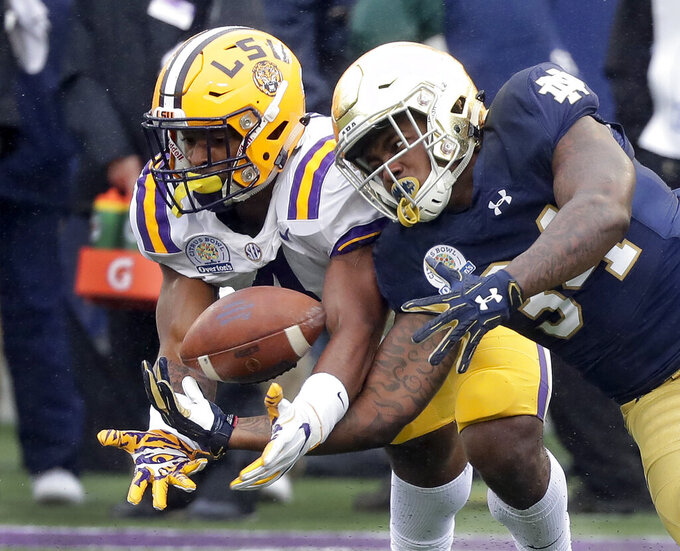 FILE - In this Jan. 1, 2018, file photo, LSU linebacker K'Lavon Chaisson, left, breaks up a pass intended for Notre Dame running back Tony Jones Jr. during the first half of the Citrus Bowl NCAA college football game in Orlando, Fla. LSU's top edge pass rusher is back and hungry after returning from a knee injury that limited him to less than one game last season. Outside linebacker K'Lavon Chaisson wants to be a difference maker for No. 6 LSU this season, and his teammates and coaches believe he will be.(AP Photo/John Raoux, File)