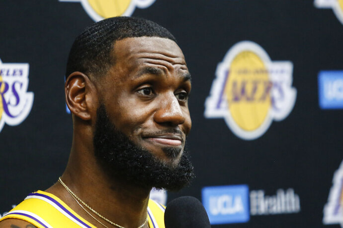 FILE - In this Sept. 27, 2019, file photo, Los Angeles Lakers forward LeBron James speaks during the NBA basketball team's media day in El Segundo, Calif. This season's NBA MVP has won the award before. A trio of past winners of the award — reigning MVP Giannis Antetokounmpo of the Milwaukee Bucks, four-time MVP LeBron James of the Los Angeles Lakers and 2017-18 winner James Harden of the Houston Rockets — were announced Saturday, Aug. 8, 2020, as the finalists for this season's top NBA individual honor. (AP Photo/Ringo H.W. Chiu, File)