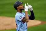 Minnesota Twins' Byron Buxton celebrates his solo home run off Detroit Tigers pitcher Tarik Skubal in the first inning of a baseball game Tuesday, Sept. 22, 2020, in Minneapolis. (AP Photo/Jim Mone)