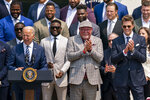 President Joe Biden, surrounded by members of the Tampa Bay Buccaneers, including Tampa Bay Buccaneers head coach Bruce Arians, second from right, and Tampa Bay Buccaneers quarterback Tom Brady, right, speaks during a ceremony on the South Lawn of the White House in Washington, Tuesday, July 20, 2021, where the president honored the Super Bowl Champion Tampa Bay Buccaneers for their Super Bowl LV victory. (AP Photo/Andrew Harnik)