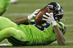 Seattle Seahawks free safety Tedric Thompson eyes the ball after he intercepted a Los Angeles Rams pass during the second half of an NFL football game Thursday, Oct. 3, 2019, in Seattle. (AP Photo/Stephen Brashear)