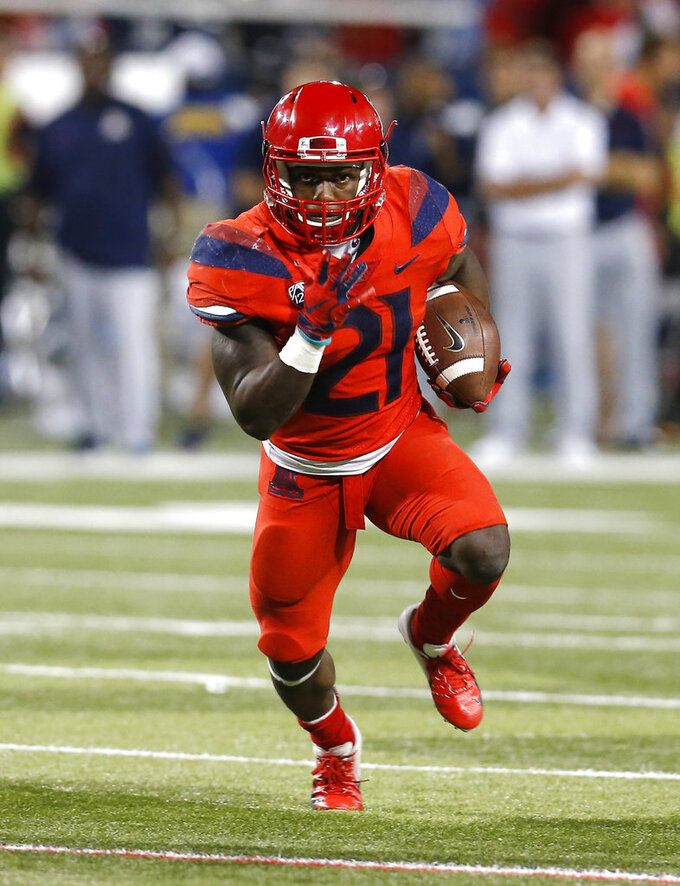 Arizona running back J.J. Taylor (21) scores a touchdown against Oregon in the second half during an NCAA college football game, Saturday, Oct. 27, 2018, in Tucson, Ariz. Arizona defeated Oregon 44-15. (AP Photo/Rick Scuteri)