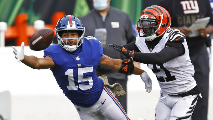 New York Giants wide receiver Golden Tate (15) reaches but cannot grab the ball under pressure from Cincinnati Bengals cornerback Mackensie Alexander (21) during the second half of NFL football game, Sunday, Nov. 29, 2020, in Cincinnati. (AP Photo/Aaron Doster)