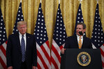 President Donald Trump listens as Tennessee Gov. Bill Lee speaks about protecting seniors, in the East Room of the White House, Thursday, April 30, 2020, in Washington. (AP Photo/Alex Brandon)