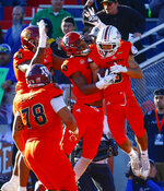 North wide receiver Andy Isabella, right, of Massachusetts, celebrates with teammates after scoring a touchdown during the second half of the Senior Bowl college football game, Saturday, Jan. 26, 2019, in Mobile, Ala. (AP Photo/Butch Dill)