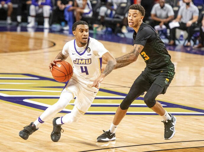James Madison guard Vado Morse (4) drives around Norfolk State guard Daryl Anderson (13) during the first half of an NCAA basketball game in Harrisonburg, Va., Friday, Nov. 27, 2020. (Daniel Lin/Daily News-Record via AP)