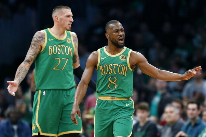 Boston Celtics' Kemba Walker (8) and Daniel Theis (27) react to a call during the first half of the team's NBA basketball game against the Brooklyn Nets in Boston, Wednesday, Nov. 27, 2019. (AP Photo/Michael Dwyer)