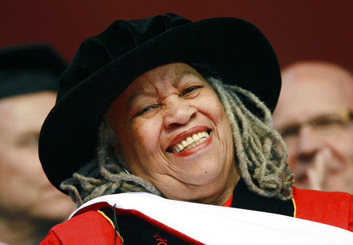 FILE - In this May 15, 2011 file photo, Pulitzer and Nobel Prize-winning author Toni Morrison smiles after delivering a speech during the Rutgers University commencement ceremony, in Piscataway, N.J. Oprah Winfrey, Ta-Nehisi Coates and Jesmyn Ward will be among the speakers at a tribute to the late Morrison. The Nobel laureate's longtime publisher, Alfred A. Knopf, announced Tuesday, Nov. 12, 2019,  that the event will take place Nov. 21 at the Cathedral of St. John the Divine, in Manhattan. (AP Photo/Julio Cortez, File)
