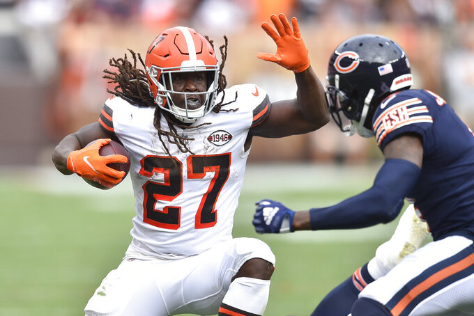 Cleveland Browns running back Kareem Hunt (27) rushes against Chicago Bears free safety Eddie Jackson (4) during the second half of an NFL football game, Sunday, Sept. 26, 2021, in Cleveland. (AP Photo/David Richard)