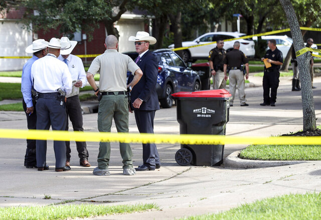 Authorities investigate the scene where a Fort Bend County Deputy Sheriff fatally shot a Fort Bend County Precinct 4 Deputy Constable after mistaking him for an intruder as they cleared a house, Friday, May 29, 2020, in Missouri City, Texas. (Jon Shapley/Houston Chronicle via AP)