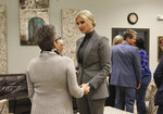 Advisor to the President Ivanka Trump holds the hands of a survivor of human trafficking at a local safe haven in Atlanta, Tuesday, Jan. 14, 2020. Ivanka Trump toured two facilities on Tuesday that help survivors in downtown Atlanta. President Donald Trump has listed fighting sex trafficking as a priority, as has the Kemp administration and Marty Kemp. (Hyosub Shin/Atlanta Journal-Constitution via AP)