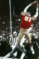"FILE - In this Jan. 10, 1982, file photo, San Francisco 49ers wide receiver Dwight Clark makes ""The Catch,"" a pass from Joe Montana that tied the game late in the fourth quarter against the Dallas Cowboys in the NFC championship football game at Candlestick Park in San Francisco.  (Phil Huber/The Dallas Morning News via AP, File)"