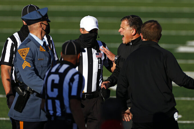 Rutgers head coach Greg Schiano argues with officials at the end of the first half of an NCAA college football game against Illinois on Saturday, Nov. 14, 2020, in Piscataway, N.J. (AP Photo/Adam Hunger)