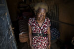 83-year-old Julia Bertila Perez poses for a photo inside her home in the Nueva Esperanza neighborhood of Lima, Peru, Friday, May 29, 2020. Quarantines and shutdowns meant to slow the spread of the new coronavirus have left millions of poor people with no way to feed their families.(AP Photo/Rodrigo Abd)