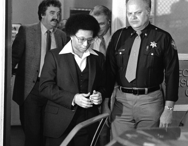 "FILE - This Feb. 23, 1982 file photo shows Wayne B. Williams leaving the Fulton County Jail in Atlanta to go to court where he will continue testifying in his trial on charges of killing two black children in Atlanta. Williams was given two life sentences in connection to two of the 29 murders. A new HBO documentary ""Atlanta's Missing and Murder: The Lost Children"" will take a deep dive into the case involving a string of murders that terrorized the city's black community 40 years ago. With Atlanta's mayor pushing to reopen in the case, the five-part series that airs Sunday will explore if Williams or anyone else was truly behind the killing spree. (AP Photo/Gary Gardiner, File)"