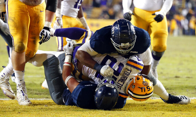 LSU running back Lanard Fournette (27) scores a touchdown in the second half of an NCAA college football game against Rice in Baton Rouge, La., Saturday, Nov. 17, 2018. (AP Photo/Gerald Herbert)