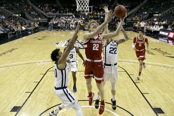 Stanford forward James Keefe (22) shoots during the first half of an NCAA college basketball game against Butler, Tuesday, Nov. 26, 2019, in Kansas City, Mo. (AP Photo/Charlie Riedel)