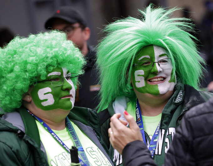 Michigan State fans arrive at U.S. Bank Stadium before the semifinals of the Final Four NCAA college basketball tournament, Saturday, April 6, 2019, in Minneapolis. (AP Photo/Matt York)